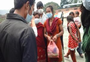 Women receiving sanitary pad and masks.